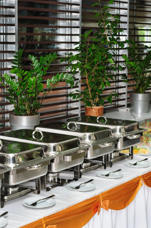 warmers: chafing dish heaters at the banquet table