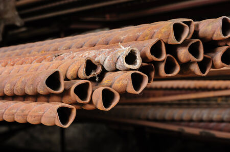 reinforcing: rusty grungy metail reinforcements at scrap-metal store Stock Photo