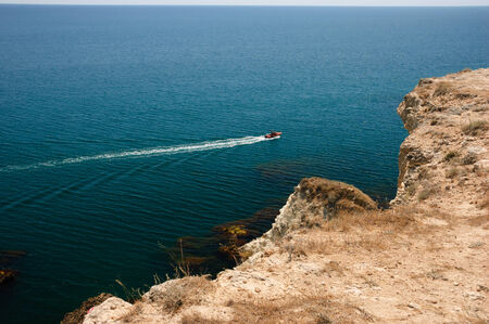 Motor boat in the sea near Tarhankut, Crimea, Black Sea, Ukraine photo