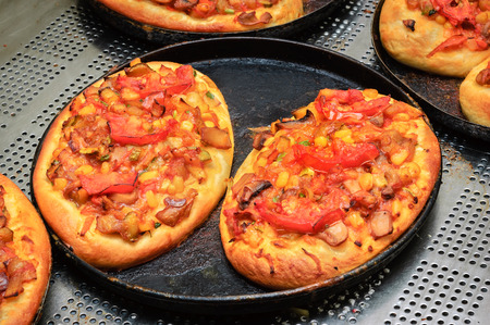 mini pizza: just baked  hot crunchy mini pizzas with cheese and tomato Stock Photo