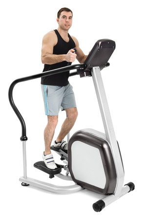 one man doing step machine exercise, on white  photo