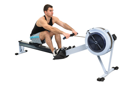 rower: man exercising on rowing machine,  hands slightly blurred in motion