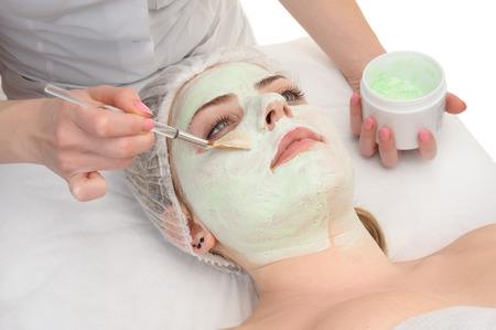 beauty salon, facial mask applying using brush photo