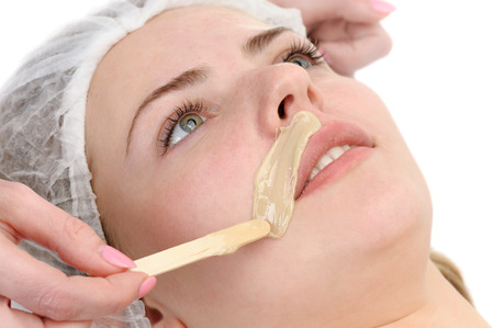 beauty salon, mustache depilation, facial skin treatment and care; focus on upper lip photo