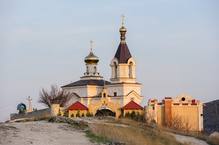 Christian Orthodox church in Old Orhei, Moldova, in rays of sunset photo