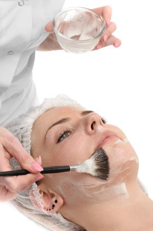 beauty salon, facial mask applying using brush Stockfoto