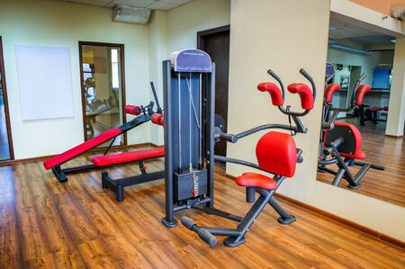 abdominal exercise: abs machine and other equipment in gym interior