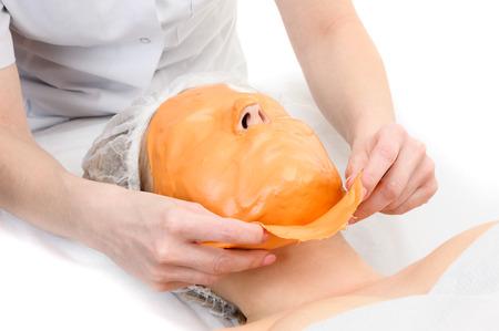 peeling: Beauty salon, removing of Alginate Peel-Off Powder facial Mask
