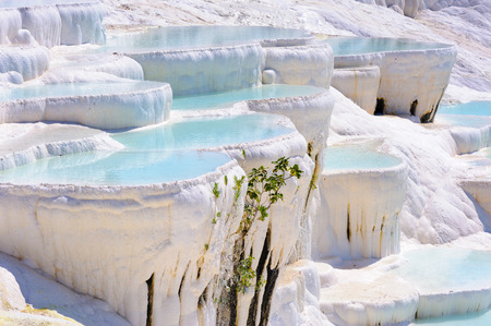 Blue cyan water travertine pools at ancient Hierapolis, now Pamukkale, Turkey photo
