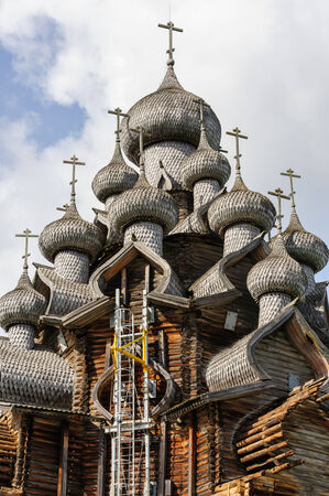 Antique wooden Church of Transfiguration at Kizhi island in Russia under reconstruction photo