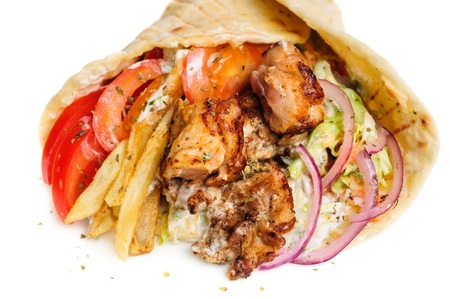 greek gyros stuffed with meat, salad, onion, tomato and potato photo