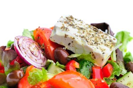 feta cheese: closeup of greek salad with large piece of feta