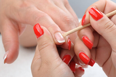 beauty salon, manicure applying, cleaning the cuticles photo