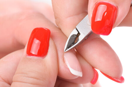beauty salon, manicure applying, cutting the cuticle with scissors