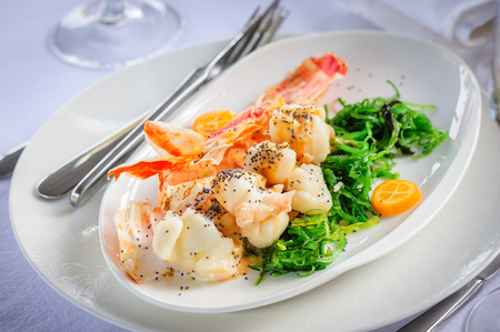 crab meat: Prepared lobster on plate