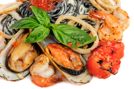 sea food: Black Pasta with sea food and basil Stock Photo