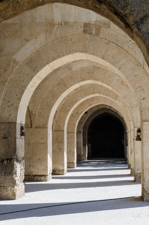 multiple arches and columns in Sultanhani caravansary on Silk Road, Turkey photo