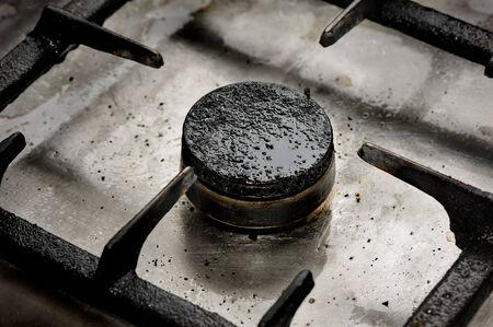 unsanitary: Dirty gas burner closeup