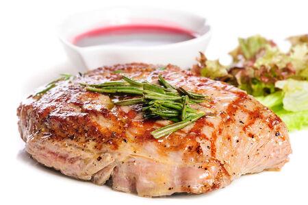 schnitzel: Grilled steaks and vegetable salad