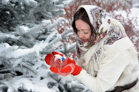 folk tales: Young Russian woman in winter park