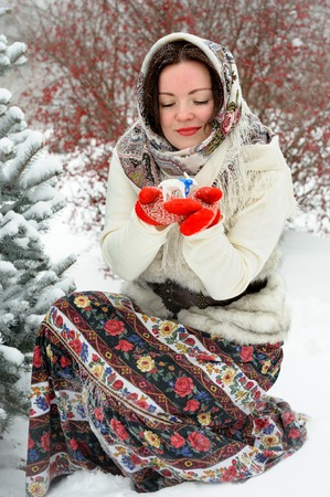 Young Russian woman in winter park photo