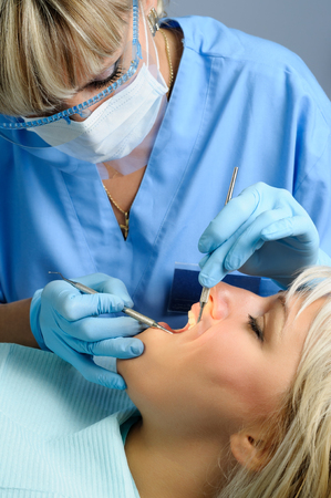 dental calculus: dentist with patient, dental calculus removal