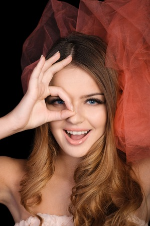 mouth cloth: Young woman shows OK sign