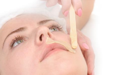depilacion con cera: depilación bigote Foto de archivo