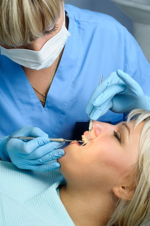 dental calculus: dentist with patient, polishing and finishing Stock Photo