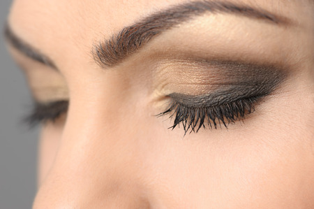 natural make up: Closed Eyes Smoky Makeup Closeup Stock Photo