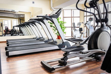 cardio fitness: Set of treadmills staying in line in the gym