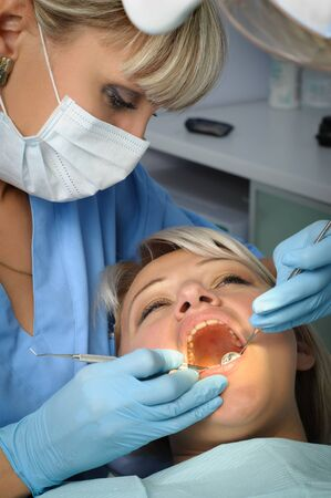 extracting: dentist with patient, dental calculus removal