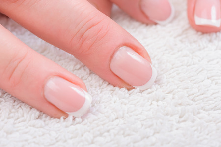 french manicure: Fingers with french manicure Stock Photo