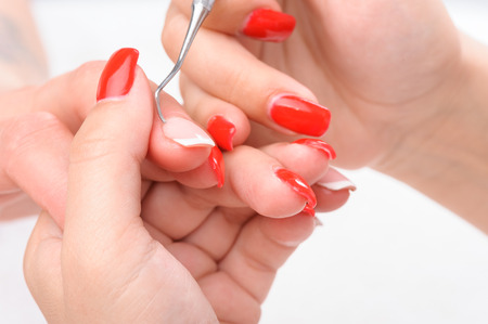 manicure applying - cleaning the cuticles photo