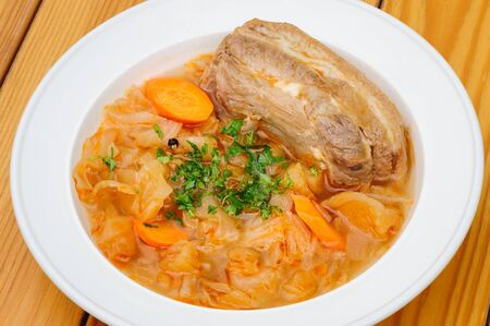 stewed: Stewed cabbage with pork meat Stock Photo