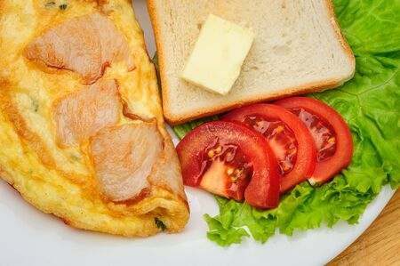 bacon and eggs: country omelette Stock Photo