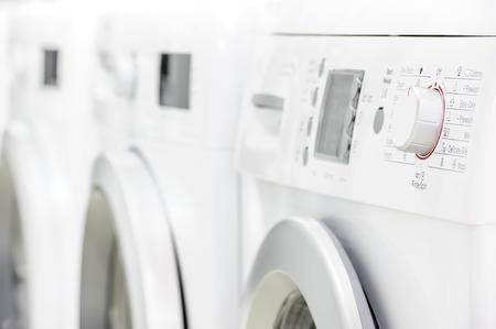 launderette: line of laundry machines