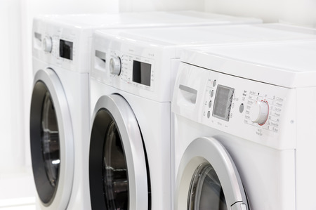 line of laundry machines