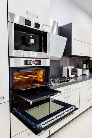 Modern custom hi-tek kitchen, oven with open door
