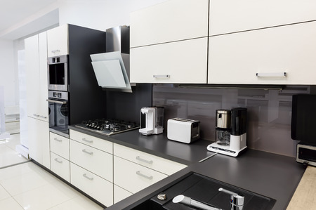 kitchen cabinets: Modern luxury hi-tek black and white kitchen interior, clean design Stock Photo