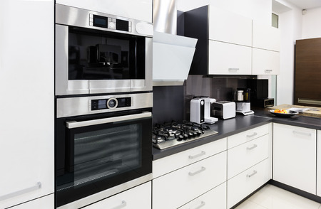 kitchen cabinet: Modern luxury hi-tek black and white kitchen interior, clean design Stock Photo