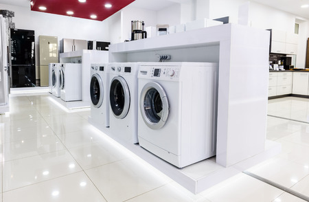wash machine: Washing machines, refrigerators and other home related appliance or equipment in the retail store Stock Photo