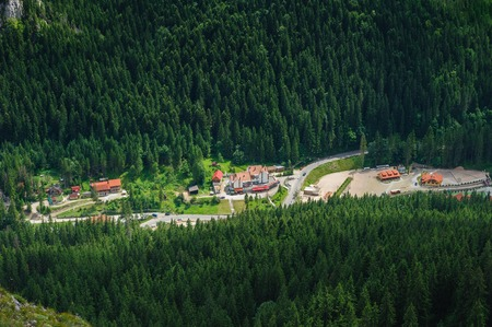 bird view: Bird view from Suhardul Mic mountain to populated valley in Red Lake AKA Lacu Rosu area, Carpathians Romania.