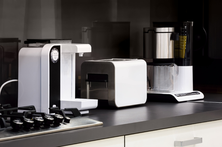 home appliance: Modern luxury black and white kitchen in high tech style