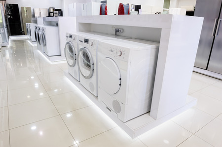 large: Washing machines, dryer and other domestic appliance equipment in the store