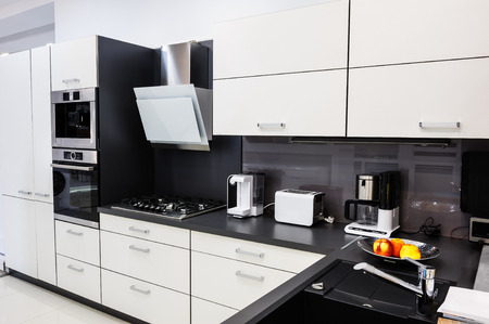 kitchen appliances: Modern luxury hi-tek black and white kitchen interior, clean design Stock Photo