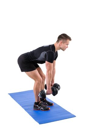 bent over: Young man shows starting position of Standing Bent Over Dumbbells Row workout, isolated on white