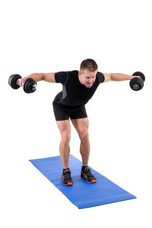 lats: Young man shows finishing position of Standing Bent Over Dumbbell Reverse Fly workout, isolated on white