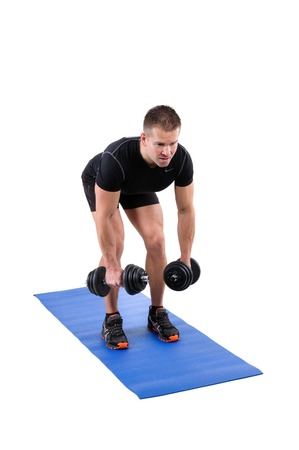 lats: Young man shows starting position of Standing Bent Over Dumbbell Reverse Fly workout, isolated on white