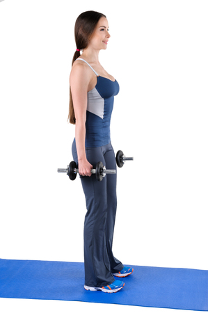 starting position: Young woman shows starting position of Standing Dumbbell Squats workout, isolated on white